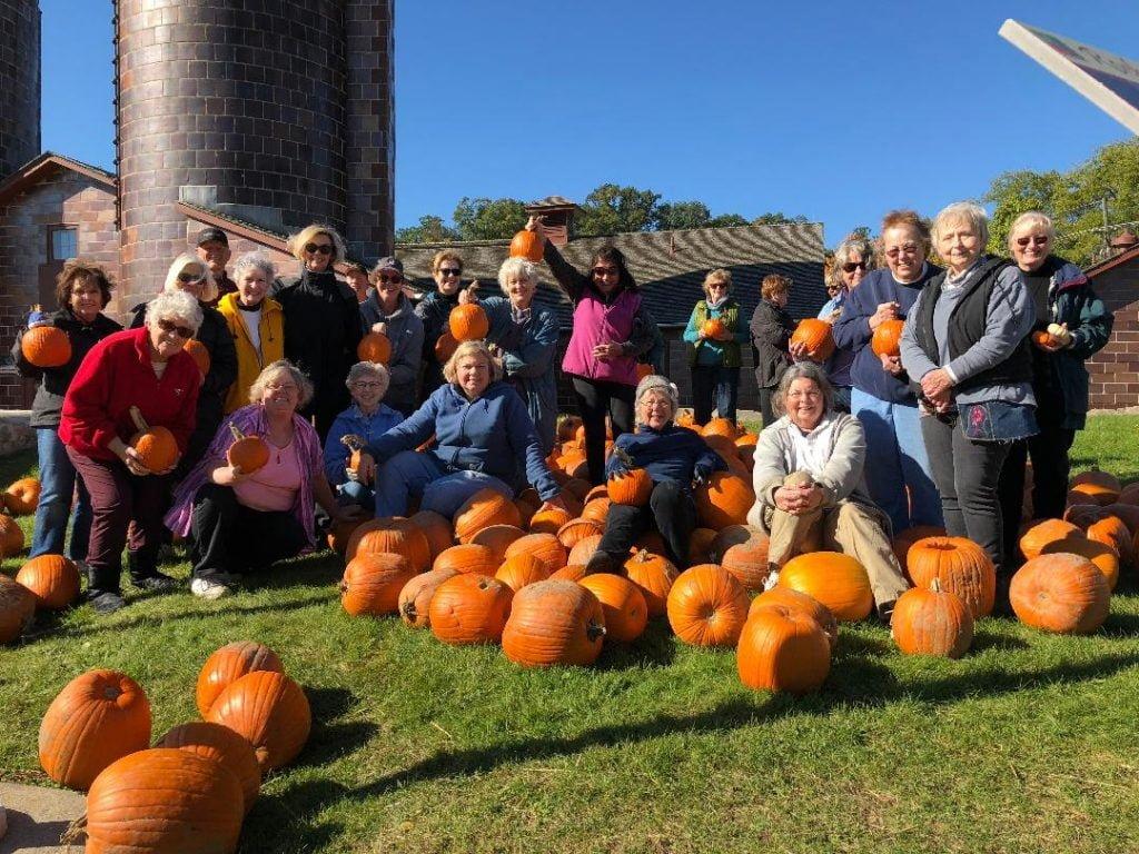 Club members enjoying a fall day amongst the pumpkins at Van Hoosen Farm